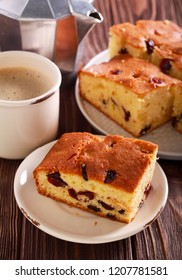 White chocolate and cranberry blondies on plate and coffee