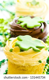 White chocolate cupcakes with white chic mousse and white buttercream frosting for St. Patrics Day.