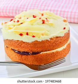 White chocolate jam and cream sponge cake