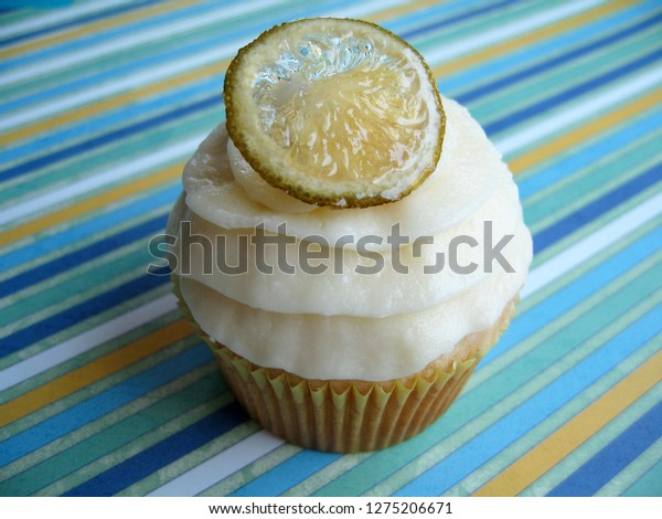 White chocolate and key lime cupcake with candied lime garnish