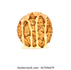 white Chocolate syrup poured on cookies isolated on white background