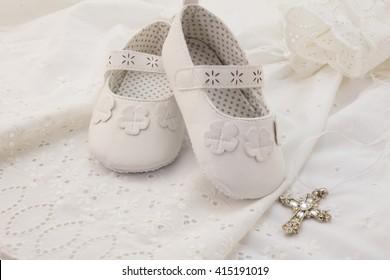 White christening baby booties, cross pendant on white