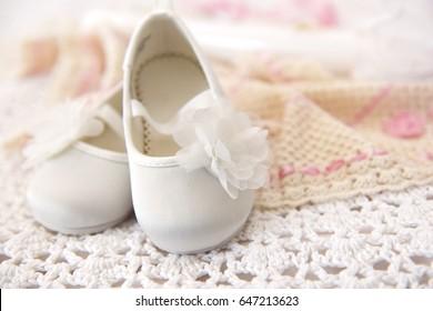 White christening baby boots on handmade crochet blanket