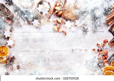 White Christmas Background with empty copy space. Cakes and nuts as a decorative xmas frame for xmas concept or cards