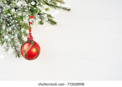 White Christmas background with fir tree and red decoration. Copy space