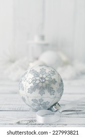 White christmas ball with decorations on light background