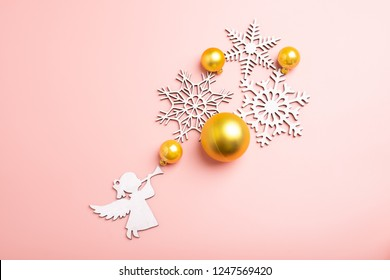 white christmas snowflakes decoration on pink background. christmas wallpaper. flat lay, top