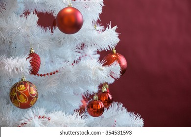 White Christmas tree with red balls