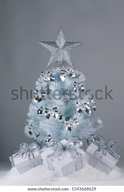 White Christmas Tree With Silver Decorations  from image.shutterstock.com