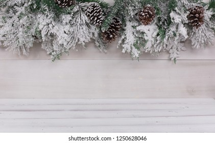 White Christmas wooden background with spruce twigs