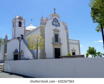 White church with blue tiles in Albufeira, Portugal