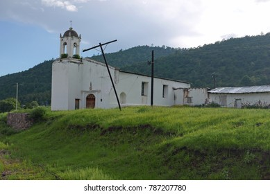 White church building along the Chepe railroad line in Northern Mexico near Copper Canyon between Creel and Cuauhtemoc in the State of Chihuahua