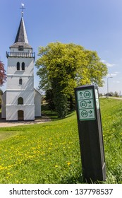 White church with directions for bicycles