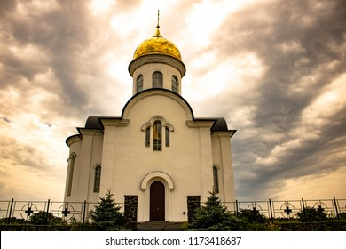 white church on a background of a cloudy sky