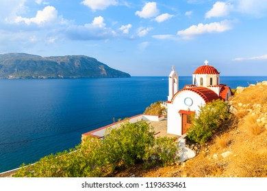 White church on high cliff above sea near Karpathos port, Karpathos island, Greece