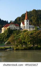 White church on hillside along the Danube River near  Melk, Austria