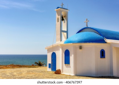 White church on a shore at sunrise in Aiya Napa, Cuprus