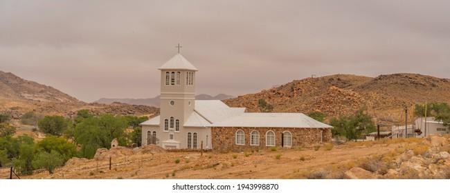 White Church from Town Aus, Namibia, background cloudy sky, Namib Naukluft Rand