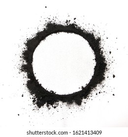 white circle of charcoal powder on white background , top view.
