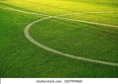 white circle line on green grass of football of soccer sport field with summer light background