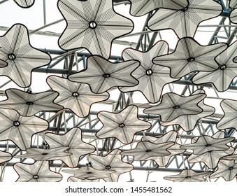 White Circular Star Shape Screen Umbrella or Parasol Installation or Construction for Sun Shading.