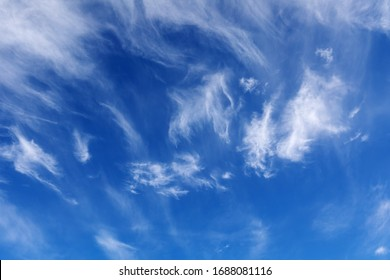 White cirrus clouds on blue sky. Cirrus clouds are thin and wispy ice clouds at a high altitude. Cloud background.