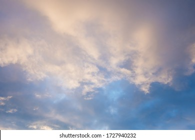 white cirrus, feathery clouds  against spring bright blue cloudy sky  at the sunset in England