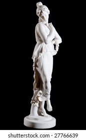 White classical marble statue of a woman with circlet of flowers isolated on black