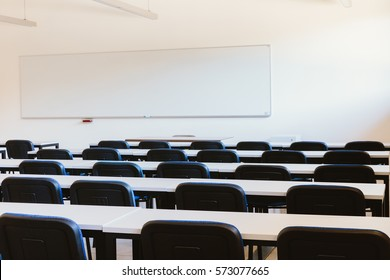 White classroom in education university with blue chairs