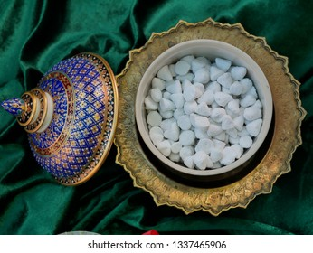White clay filler contained in the Thai benjarong jar. (Concept image for Songkran festival)