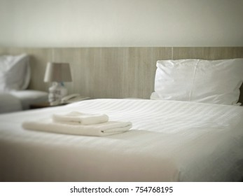 White and clean comfort hotel room ready for guest by selected focus frame