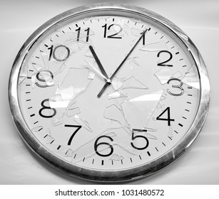 White clock broken on white background, braking time concept