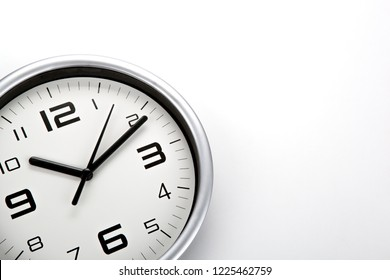 white clock face with black digits on a white background