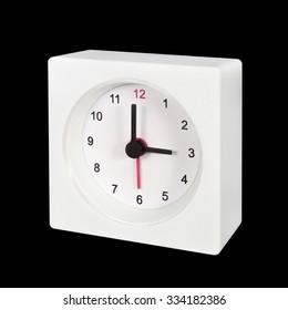 white clock isolated on black