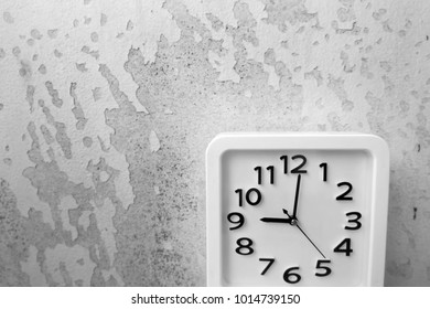 White Clock Isolated. Time Nine Alarm Clock on Old Gray Crack Wall Background Great For Any Use.