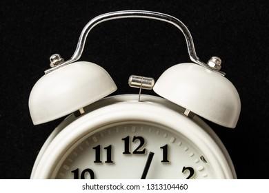 White clock on dark background