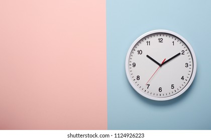 White clock on pastel  color background