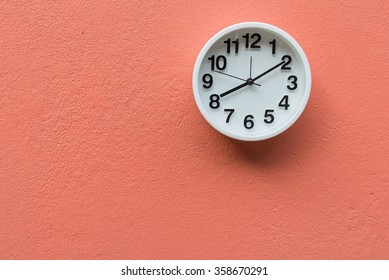 White clock on wall Coral colour