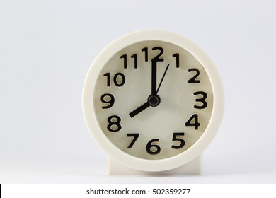 White clock at time number 8 isolated