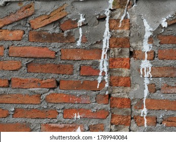 white clolor smears on a rushly built temple wall