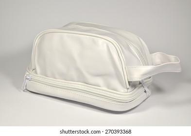 White closed plastic cosmetic bag with two zips