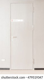 """A white closed steel door, Sign warning """" NO Entry """""""