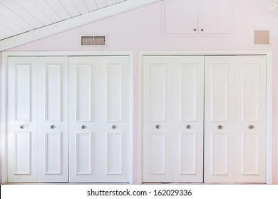 White closet door in pink room