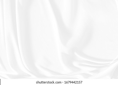 White cloth background abstract. Fabric is wrinkled and sofe wave. Material are used in textile assembly. detail texture of pattern design, elegance with free space copy for backdrop or wallpaper.