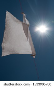 white cloth hanging on a washing line