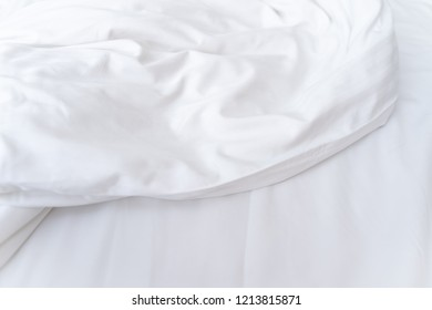 White cloth in hotel bedding sheet with softer wave use for background wallpaper