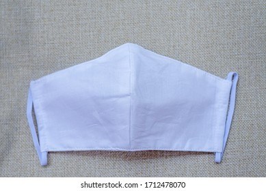White cloth mask made from muslin cotton.