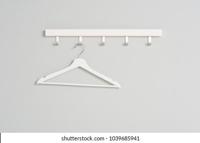 White Clothes hanger on a gray wall background