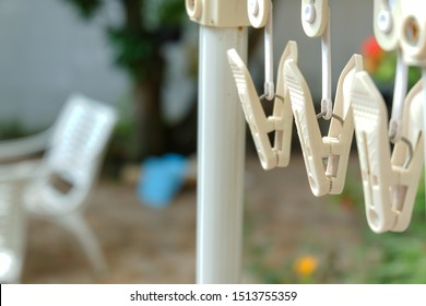 white clothes hangers clips with blurred background.