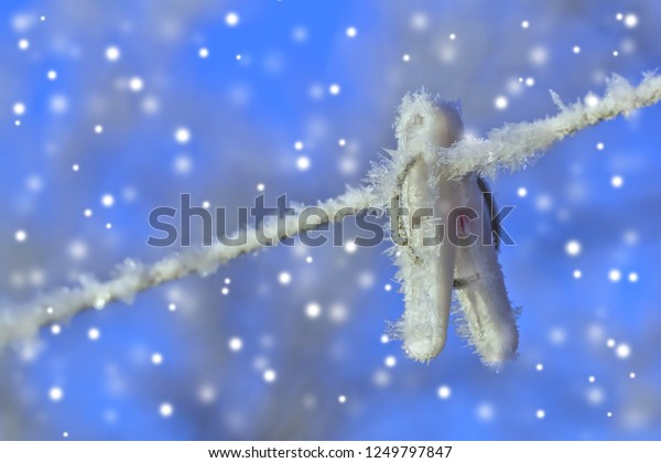 white-clothespin-covered-hoarfrost-brigh